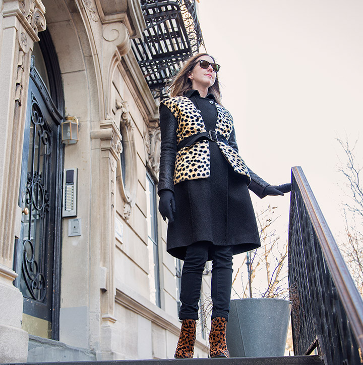 3 Ways To Update Your Winter Coat- Layer a Vest Over It . Vintage cheetah vest, zara leopard boots, rayban wayfarers, black peacoat with leather sleeves, black skinny jeans, women's fashion, park slope brownstone brooklyn ny