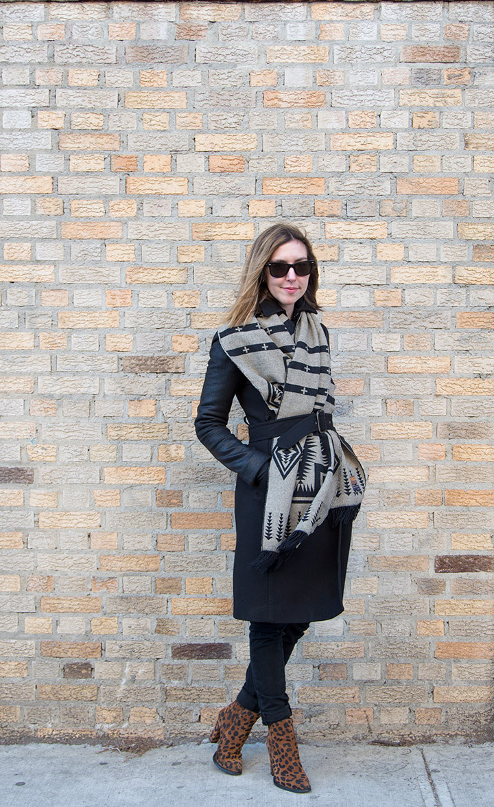 3 Ways To Update Your Winter Coat- Wrap a scarf around it . Women's Fashion, black peacoat with leather sleeves, navajo print blanket scarf, pendleton woolen mills scarf,  rayban wayfarers, brick wall